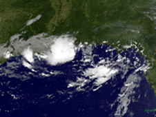 Tropical Depression 5's clouds as a circular shape over southeastern Louisiana and coastal Mississippi.