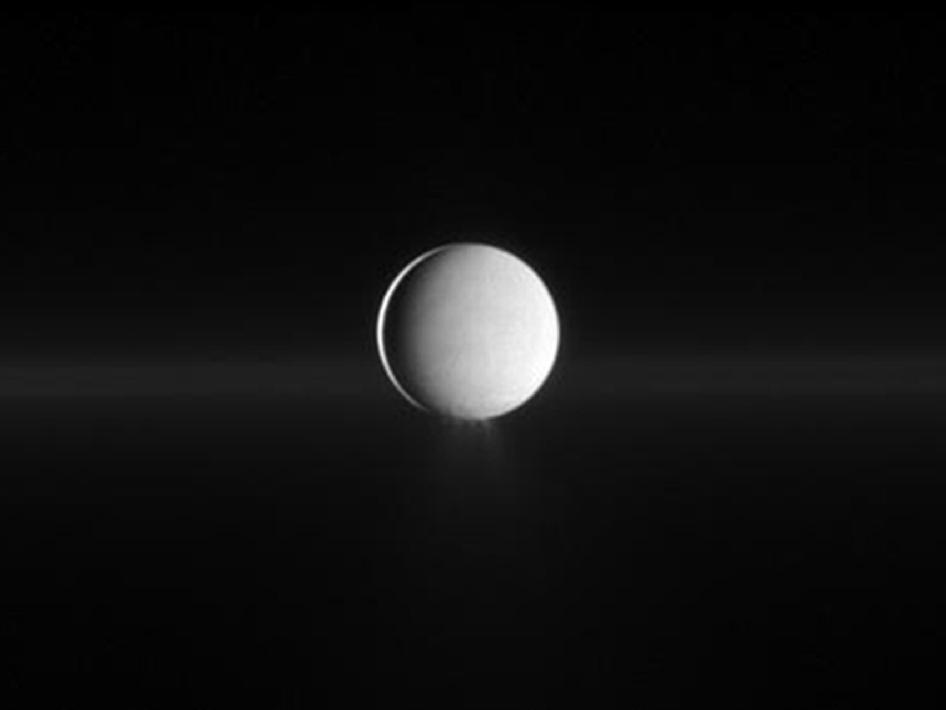 Enceladus in front of Saturn's G ring