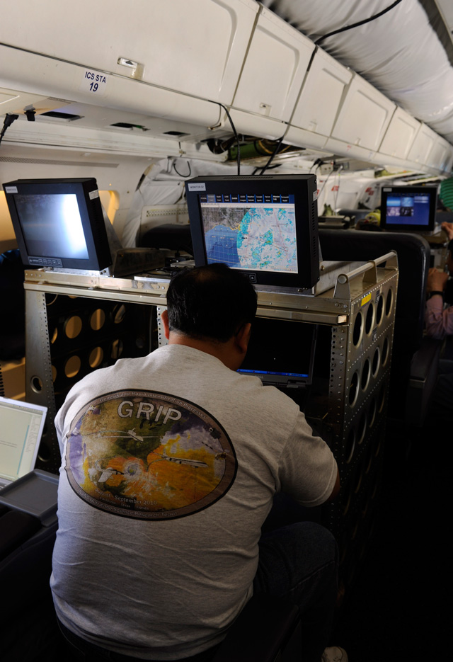 A researcher with the GRIP experiment works aboard the NASA DC-8 during a flight over the Gulf of Mexico, Tuesday, Aug. 17, 2010