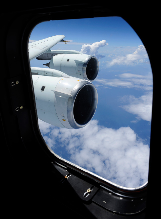 Cloud formations are seen through the window of NASA DC-8 aircraft during a flight, Tuesday, Aug. 17, 2010, over the Gulf of Mexico