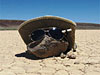 A rock wearing a hat and sunglasses