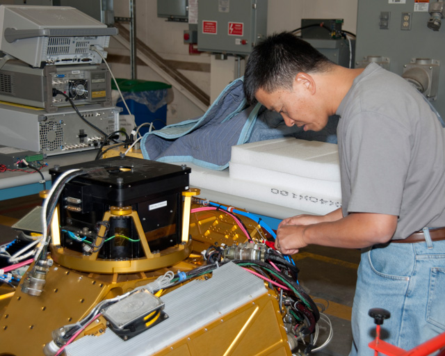Goddard's Lihau Li prepares the High-Altitude Imaging Wind and Rain Profiler, or HIWRAP, for installation on NASA's Global Hawk