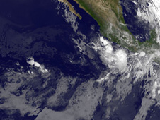 GOES-11 captured an infrared image of Tropical Storm Frank (right), still lingering of southwestern Mexico's coast.