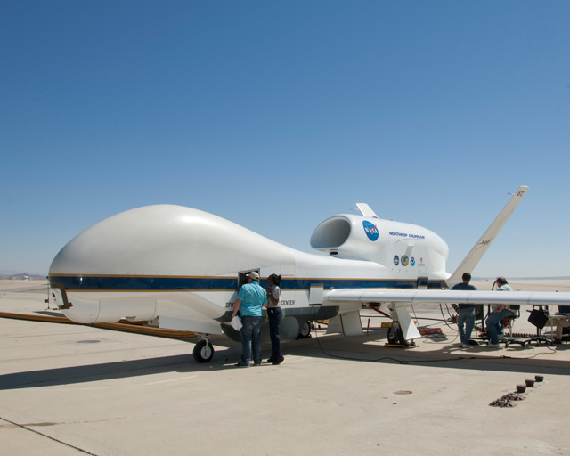 NASA and Northrop Grumman engineers and technicians prepare a NASA Global Hawk for a combined systems communication test