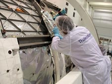 Technician is shown installing multi-layer insulation on the Meteoroids and Debris Protective Shield of the Permanent Multipurpose Module.
