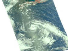 Tropical Storm Kompasu (the swirl of clouds in the middle of the image) moving into the Yellow Sea; Japan is to the north.