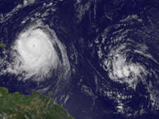Hurricane Earl (left) and the low pressure area (right) that has a 90% chance of becoming Tropical Depression 8.