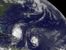 In this image are Hurricane Earl (lower left), Tropical Storm Fiona located to Earl's east, and Tropical Storm Danielle far in the Northern Atlantic.