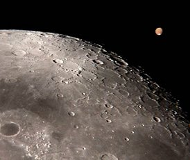 Using an 8-inch telescope and a digital camera, Ron Wayman of Tampa, FL, took this picture of a close encounter between the Moon and Mars on July 17, 2003