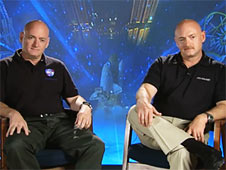 Astronauts and brothers Scott (left) and Mark Kelly are interviewed before their missions
