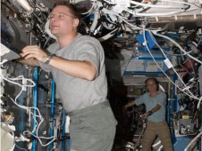 NASA astronauts Doug Wheelock and Shannon Walker working in the Destiny laboratory on the International Space Station