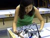 A student working with a robot