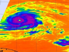 This image shows a clear and large eye, very strong convection (purple) and high, powerful thunderstorm cloud tops around Igor's center.