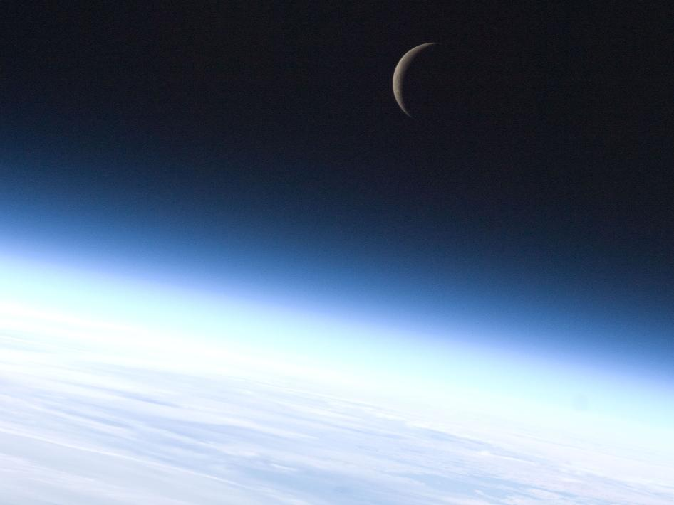 Crescent moon above Earth's horizon