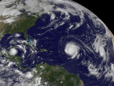 GOES-13 captured an image of Tropical Storm Karl and Hurricanes Igor and Julia in one image on Sept. 15