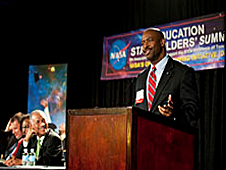 Astronaut and Education Design Team Co-Chair Leland Melvin speaking at a podium