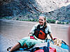 Tanya Petach sits on a raft in a river