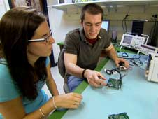 Jennifer Williams and Robert Carroll, Undergraduate Physics Students at Siena College Loudonville, N.Y. work on instrument electronics for the Firefly mission.