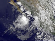 Tropical Storm Georgette's (left) clouds reaching into Baja California, Mexico at 13:15 UTC 9:15 a.m. EDT on Sept. 21.