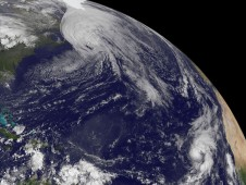 This visible satellite image of Hurricane Igor as he moves into the Canadian Maritimes and Tropical Storm Lisa in the far eastern Atlantic.