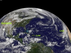 Tropical Storm Lisa (right), a developing tropical low (center), and Tropical Storm Georgette (far left).