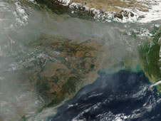 Heavy haze hugged the southern face of the Himalaya in mid-December 2009.