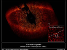 Simulated images of the ancient Kuiper Belt bear a striking resemblance to this Hubble Space Telescope view of the dusty ring around Fomalhaut, a young star located 25 light-years away in the constellation Piscis Austrinus.
