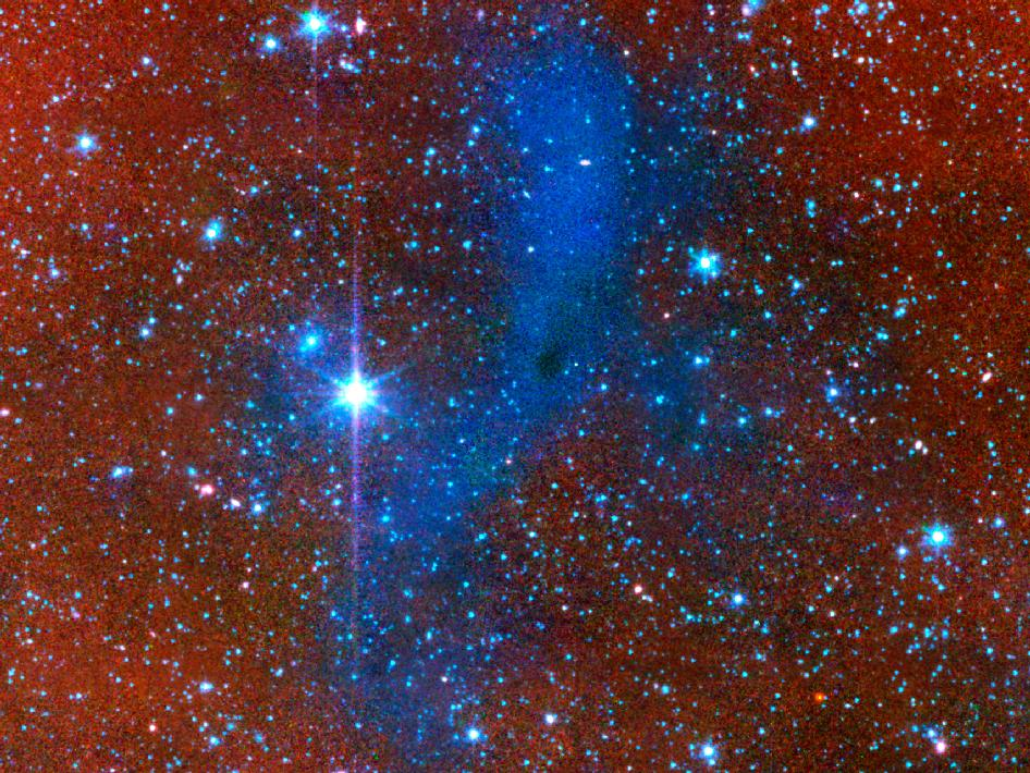 A series of images from NASA's Spitzer Space Telescope shows a dark mass of gas and dust