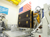Ball Aerospace technicians perform a partial deploy of NASA's NPP weather satellite's solar array