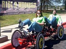 Smith and a co-worker pedal a moonbuggy