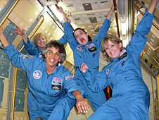 Four people pretending to float in microgravity