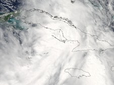 MODIS captured this visible image of Nicole over Cuba before it weakened back into a tropical depression.