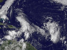 GOES-13 captured System 97L in the eastern Caribbean Sea and another low behind it in the central Atlantic Ocean