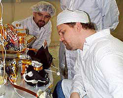 scientists study Lander in lab