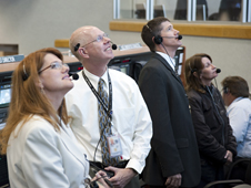 NASA test directors Charlie Blackwell-Thompson, Steve Payne and Jeremy Graeber, and Orbiter Test Conductor Teresa Annulis, watch liftoff.