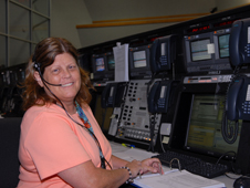 Roberta Wyrick monitors the OTC console as space shuttle Discovery rolls to the VAB.