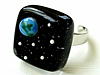 Adjustable ring with an Earth- and space-themed glass setting