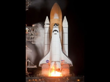 Space shuttle main engines igniting