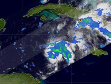 NASA's TRMM satellite noticed light to moderate rainfall within System 99L.