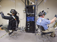 Drew (at left), Bowen (at right) wear virtual reality equipment during a training session