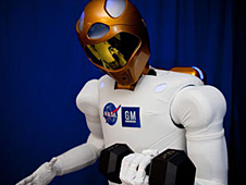 Robonaut 2 holds a 20-pound weight