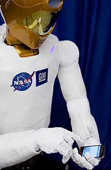 Robonaut 2 holding a smartphone