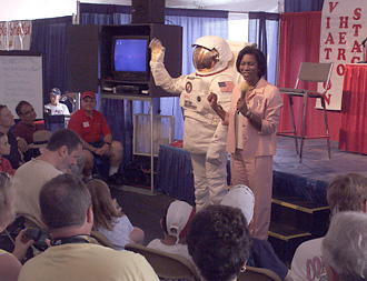 A suited astronaut joined NASA associate administrator for education