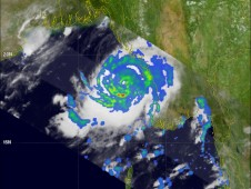 This TRMM image shows moderate to heavy rain showers were surrounding Cyclone Giri's partially-formed eye.