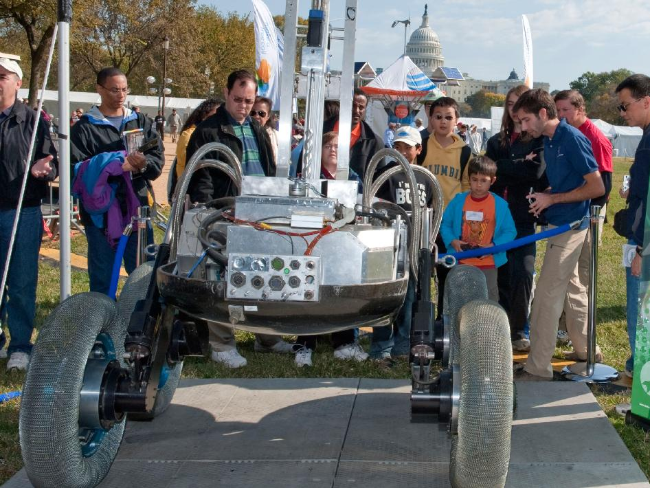 Visitors to the USA Science and Engineering Festival look on at one of the many exhibits, Saturday, Oct. 23, 2010, on the National Mall in Washington. NASA, joined with more than 500 science organizations this weekend to inspire the next generation of scientists and engineers during the first nation