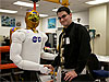 Kody Ensley shakes hands with Robonaut 2