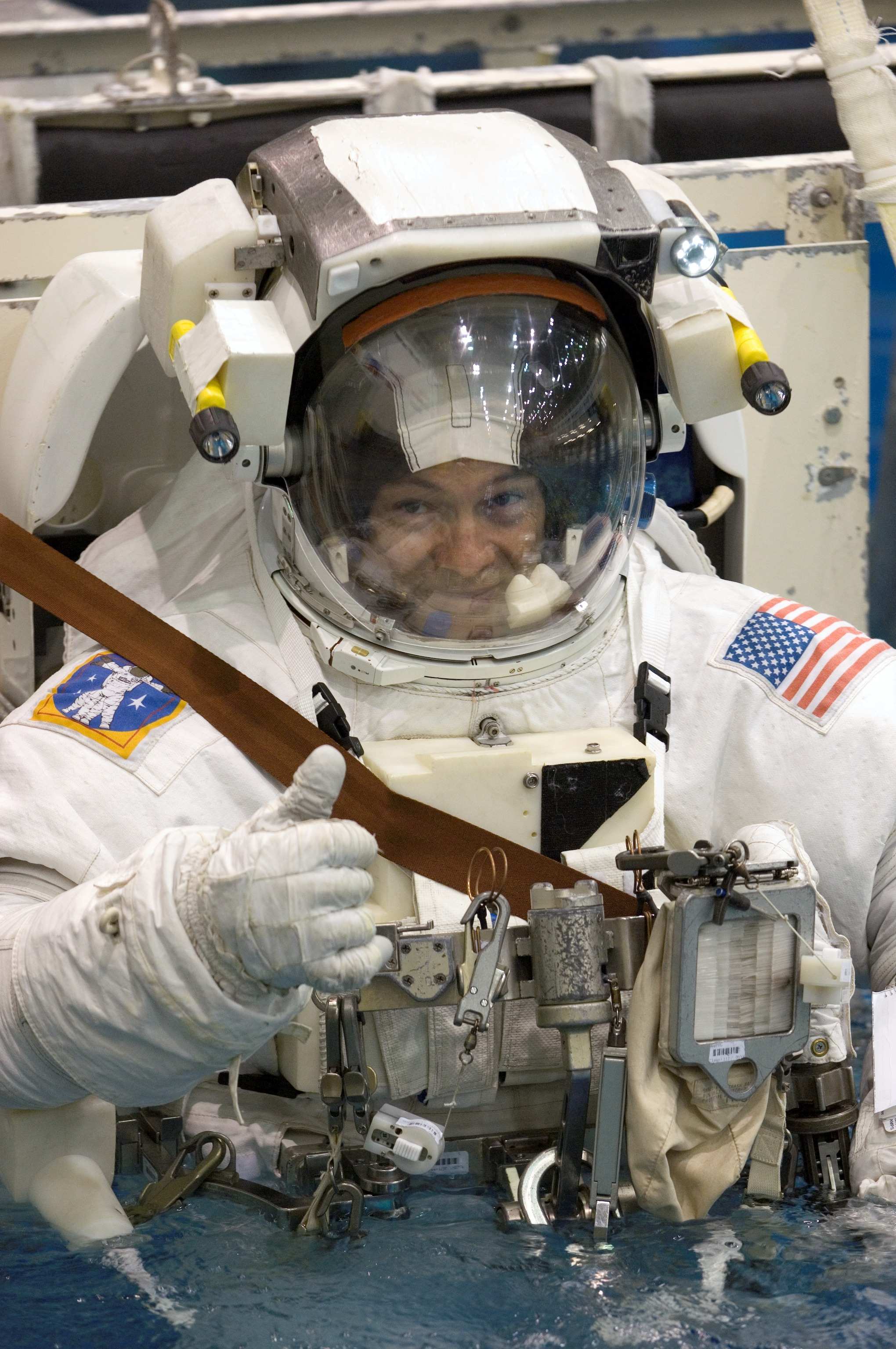 an astronaut in her space suit weighs 300 - photo #13