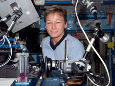 ISS016-E-005730: Peggy Whitson with Capillary Flow Experiment