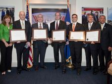 Members of the NASA team involved in the rescue of the Chilean miners are honored by NASA Administrator Charles Bolden and NASA Deputy Administrator Lori Garver on Thursday, Oct. 28, 2010 at NASA Headquarters in Washington. From Left: NASA Deputy Administrator Lori Garver, Dr. Clint Cragg, Dr. Michael Duncan, Dr. Albert Holland, Dr. James Polk, Albert Condes and NASA Administrator Charles Bolden.