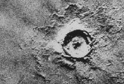 Young crater on Mars displaying lobate ejecta patterns.
